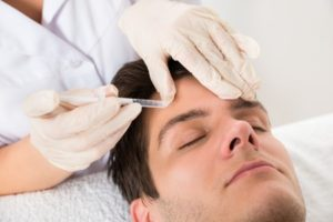 43693618 - young man having botox treatment at beauty clinic